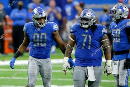 Detroit Lions defensive end Trey Flowers (90) and Detroit Lions nose tackle Danny Shelton (71) play against the New Orleans Saints during the second half of an NFL football game, in Detroit