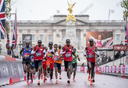 Eliud Kipchoge (C, Front) of Kenya competes in the Elite Men's Race at the London Marathon 2020 in central London, Britain, on Oct. 4, 2020.