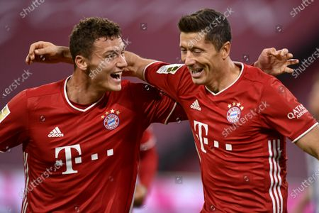 Bayern's Robert Lewandowski (R) celebrates with Bayern's Benjamin Pavard (L) after scoring a goal during the German Bundesliga soccer match between Bayern Munich and Hertha BSC Berlin in Munich, Germany, 04 October 2020.