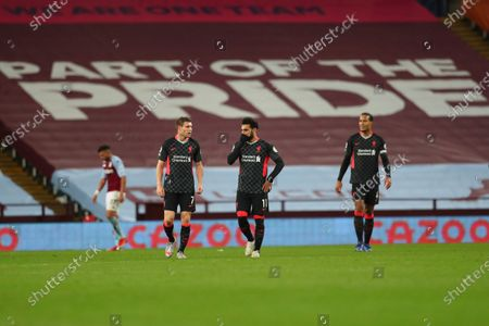 Liverpool's Mohamed Salah, center, Liverpool's James Milner, left, and Liverpool's Virgil van Dijk react after, Aston Villa's Jack Grealish scores his side's seventh goal during the English Premier League soccer match between Aston Villa and Liverpool at the Villa Park stadium in Birmingham, England