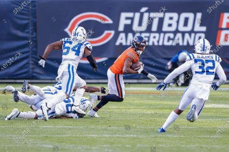 Chicago Bears' Darnell Mooney (11) is tackled by Indianapolis Colts' Bobby Okereke (58) and Kenny Moore II (23) during the second half of an NFL football game, in Chicago