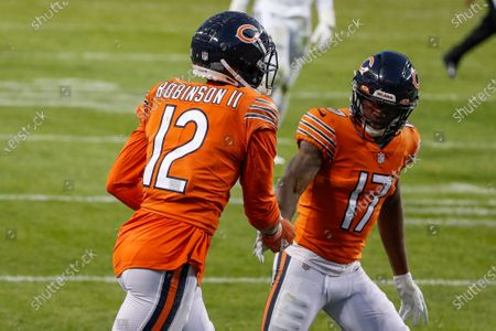 Chicago Bears' Allen Robinson (12) is congratulated by Anthony Miller (17) after scoring a touchdown against the Indianapolis Colts during the second half of an NFL football game, in Chicago