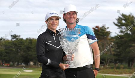 Mel Reid, left, and caddie Ryan Desveaux celebrate with trophy after Reid won the Shoprite LPGA Classic golf tournament, in Galloway, N.J