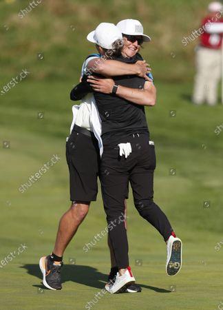 Mel Reid, front hugs caddie Ryan Desveaux after winning the Shoprite LPGA Classic golf tournament, in Galloway, N.J