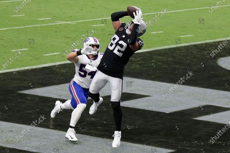 Las Vegas Raiders tight end Jason Witten (82) catches a touchdown pass over Buffalo Bills outside linebacker A.J. Klein (54) during the first half of an NFL football game, in Las Vegas