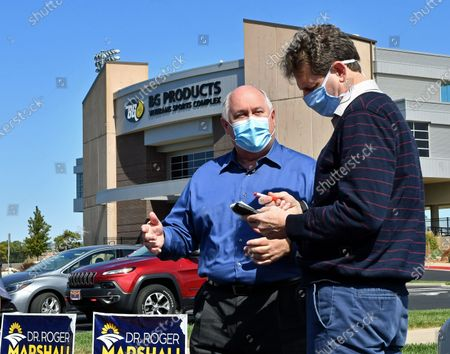 Stock Image of Congressman Ron Estes (R-KS) who is running for re- election in the 4th congressional district wears a surgical mask while being interviewed by a local reporter at the kick off the Keep Kansas Great Bus Tour in  El Dorado