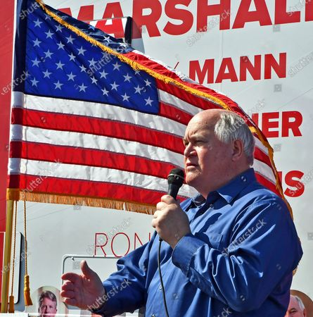 Congressman Ron Estes (R-KS) who is running for re- election in the 4th congressional district addresses the small crowd of supporters at the kick off the Keep Kansas Great Bus Tour in  El Dorado