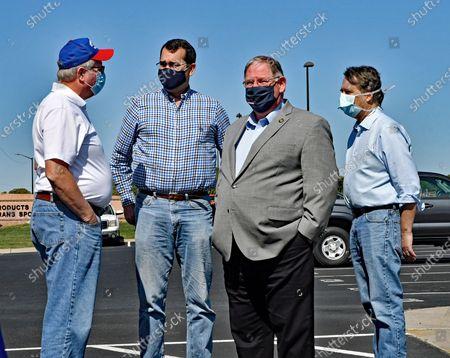 Kansas Minority leader Jim Ward, Attorney General Derek Schmidt, Majority leader Dan Hawkins and former Governor Doctor Jeff Colyer all are wearing masks at the kick off the Keep Kansas Great Bus Tour in  El Dorado
