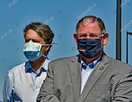 Stock Photo of Former Kansas Governor Doctor Jeff Colyer and Majority leader Dan Hawkins wearing masks at the kick off the Keep Kansas Great Bus Tour in  El Dorado