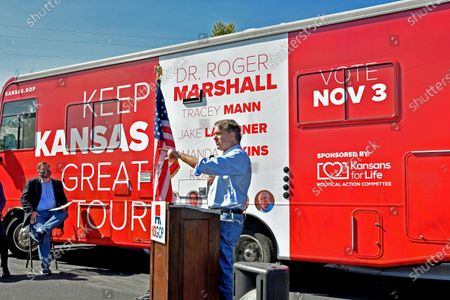 """Stock Photo of Congressman Ron Estes (R-KS) who is running for re- election in the 4th congressional district wears a surgical mask at the kick off the """"Keep Kansas Great Bus Tour"""" in  El Dorado"""