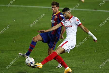 Barcelona's Sergi Roberto fights for the ball against Sevilla's Youssef En-Nesyri during the Spanish La Liga soccer match between FC Barcelona and Sevilla FC at the Camp Nou stadium in Barcelona, Spain