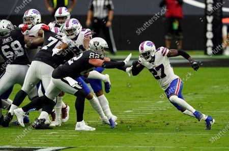 Las Vegas Raiders tight end Jason Witten #82 blocks Buffalo Bills cornerback Tre'Davious White #27 during the first half of an NFL football game, in Las Vegas