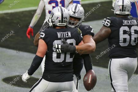 Las Vegas Raiders offensive tackle Denzelle Good embraces tight end Jason Witten (82) after Witten scored a touchdown against the Buffalo Bills during the first half of an NFL football game, in Las Vegas