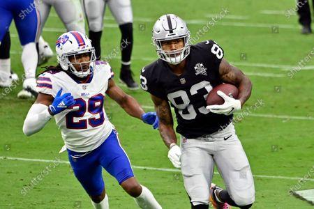 Las Vegas Raiders tight end Darren Waller (83) runs with the ball against Buffalo Bills cornerback Josh Norman (29) during the first half of an NFL football game, in Las Vegas