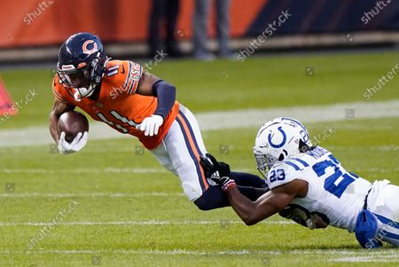 Stock Image of Chicago Bears' Darnell Mooney (11) is tackled by Indianapolis Colts' Kenny Moore II (23) during the second half of an NFL football game, in Chicago