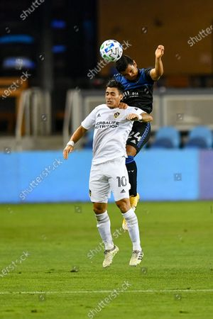 San Jose Earthquakes defender Nick Lima (24) heads a ball above Los Angeles Galaxy forward Cristian Pavon (10) during the MLS game between the LA Galaxy and the San Jose Earthquakes at Avaya Stadium in San Jose, California