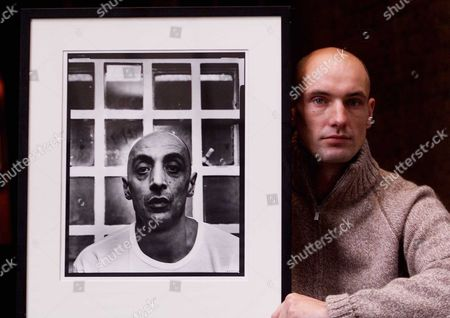 Stock Picture of The Still Lifers 6 Months Behind Bars To Capture Prison Portraits Sam Barker 28 From Islington Who Has A Photographic Exhibition On Prisoners At The Sosho Match Bar In Shoreditch. Pic Of John Dexter Seving 23 Years For Armed Robbery