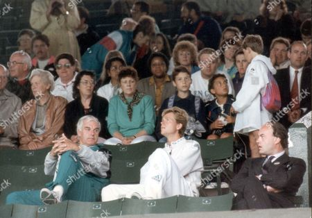 Stock Image of Stefan Edberg - Tennis Player - 1991 Watching And Waiting: Stefan Edberg Seems To Looking For A Break In The Weather As He Waits With Coach Tony Pickard At Wimbledon Yesterday. Sweden's Stefan Edberg And Coach Sit On The Centre Court.... Picture Desk ** Pkt 4701-346261