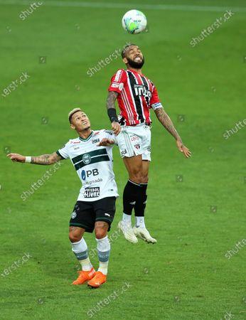 Neilton of Coritiba and Daniel Alves of Sao Paulo challenge for a header