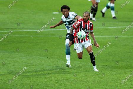 Sabino of Coritiba and Daniel Alves of Sao Paulo chase a through ball