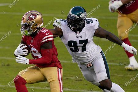 San Francisco 49ers wide receiver Deebo Samuel (19) runs against Philadelphia Eagles defensive tackle Malik Jackson (97) during the first half of an NFL football game in Santa Clara, Calif