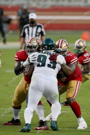 San Francisco 49ers offensive guard Laken Tomlinson (75) and offensive tackle Trent Williams (71) double team Philadelphia Eagles nose tackle Javon Hargrave (93) during an NFL football game, in Santa Clara, Calif