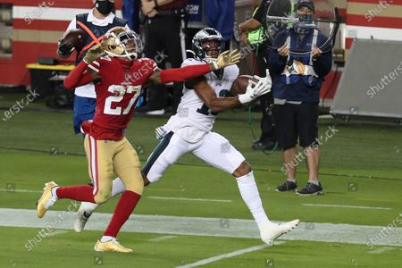 Philadelphia Eagles wide receiver Travis Fulgham (13) catches a touchdown pass in front of San Francisco 49ers cornerback Dontae Johnson (27) during the second half of an NFL football game in Santa Clara, Calif