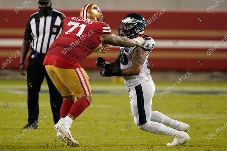 Stock Photo of San Francisco 49ers offensive tackle Trent Williams (71) blocks Philadelphia Eagles defensive end Derek Barnett (96) during an NFL football game in Santa Clara, Calif