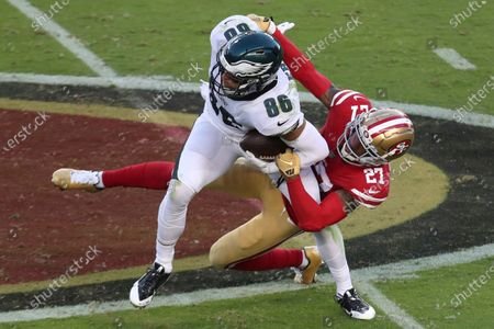 Philadelphia Eagles tight end Zach Ertz (86) is grabbed by San Francisco 49ers cornerback Dontae Johnson (27) during the first half of an NFL football game in Santa Clara, Calif