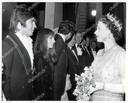 Queen Elizabeth II Being Presented To Singers Esther And Abi Ofarim At The London Palladium Gala Performance In Aid Of The British Olympic Fund.