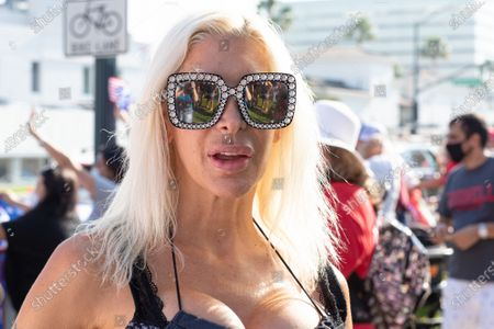 Frenchy Morgan and other protesters attend a MAGA and QAnon Rally