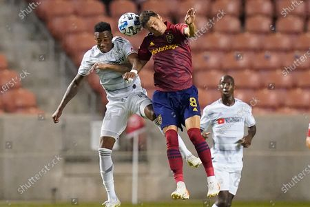 Stock Image of Real Salt Lake midfielder Damir Kreilach (8) and Los Angeles FC midfielder Mark-Anthony Kaye, left, vie for a head ball during the first half of an MLS soccer match, in Sandy, Utah