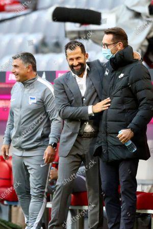Bayern sports director Hasan Salihamidzic, left, welcomes Hertha's manager Michael Preetz prior to the German Bundesliga soccer match between FC Bayern Munich and Hertha BSC Berlin in Munich, Germany