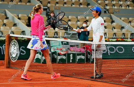 Petra Kvitova of the Czech Republic is congratulated by her opponent Shuai Zhang of China after winning her fourth round match