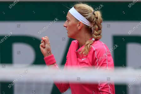 Petra Kvitova of the Czech Republic clenches her fist after scoring a point against China's Zhang Shuai in the fourth round match of the French Open tennis tournament at the Roland Garros stadium in Paris, France