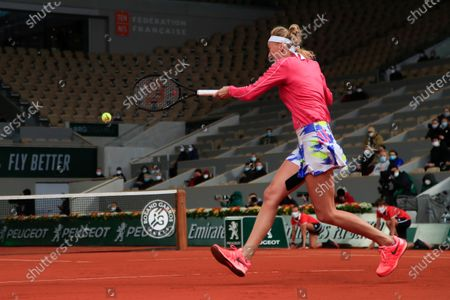 Petra Kvitova of the Czech Republic plays a shot against China's Zhang Shuai in the fourth round match of the French Open tennis tournament at the Roland Garros stadium in Paris, France