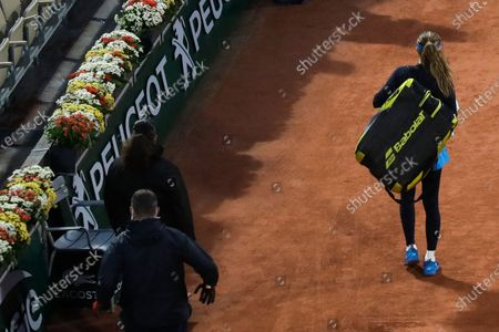 Stock Photo of Danielle Collins of the U.S. leaves Suzanne Lenglen court as it started to rain prior to the fourth round match of the French Open tennis tournament against Tunesia's Ons Jabeur at the Roland Garros stadium in Paris, France, . Rain interrupted the start of play twice