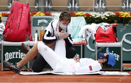 Zhang Shuai China receives treatment during her 4th round match against Petra Kvitova of the Czech Republic at the French Open tennis tournament at Roland Garros in Paris, France, 05 October 2020.