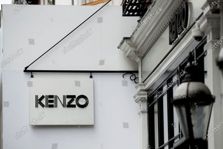 Sign is displayed oustside a branch of the clothing store Kenzo, founded by the iconic French-Japanese fashion designer Kenzo Takada, in London, . Takada's family said in a statement to French media Sunday that Takada died from complications from COVID-19 in a hospital in Neuilly-sur-Seine, near Paris. He was 81