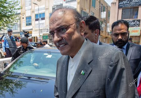 Former Pakistani President Asif Ali Zardari leaves the High Court building, in Islamabad, Pakistan. On, a Pakistani court charged Zardari in two corruption cases, escalating the legal challenges facing the now leading opposition lawmaker and widower of assassinated former Pakistani Prime Minister Benazir Bhutto. The development came as Zardari's party and a key anti-government ally were preparing for a massive rally against Prime Minister Imran Khan later this month
