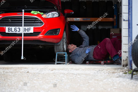 Stock Photo of Emmerdale - Ep 8865 Monday 19th October 2020 After returning to work in the garage Dan Spencer, as played by Liam Fox, finds himself stuck and unable to get up.