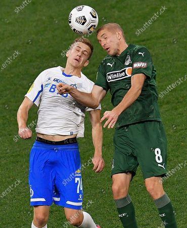 Daniil Fomin of Dynamo (left) and Yury Gazinsky of Krasnodar (right)