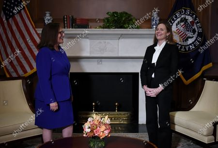 Judge Amy Coney Barrett, United States President Donald J. Trump's nominee for the US Supreme Court, meets with US Senator Deb Fischer (Republican of Nebraska) at the US Capitol in Washington, DC.