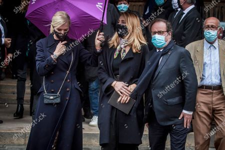 French former President Francois Hollande (R) and his wife Julie Gayet (C) attend the funeral ceremony of French singer Juliette Greco at the Saint-Germain-des-Pres church in Paris, France, 05 October 2020. Juliette Greco died at the age of 93 on 23 September 2020.