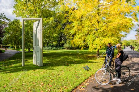 Stock Picture of Gavin Turk, L'Âge d'Or (Green & Red), 2019 - Frieze Sculpture, the largest outdoor exhibition in London. Work by 12 leading international artists in Regent's Park from 5th October - 18h October in a free showcase.