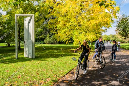 Stock Photo of Gavin Turk, L'Âge d'Or (Green & Red), 2019 - Frieze Sculpture, the largest outdoor exhibition in London. Work by 12 leading international artists in Regent's Park from 5th October - 18h October in a free showcase.