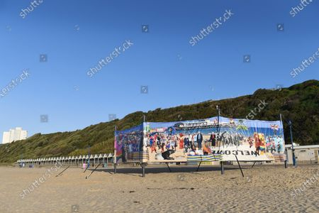 Stock Picture of Artwork ban in Bournemouth  One side of the windbreak was deemed acceptable while the other has been covered up by the council.  A satirical artist has hit out at a local council after town hall bureaucrats ordered him to cover up part of his display on a popular beach.  Christopher Spencer, better known as 'Cold War Steve', had hoped to show his double sided windbreak on Boscombe Beach in Dorset.  The 82ft piece was designed to have a 'hopeful side' and a 'dark side' featuring figures from popular culture and politics.  The dark side included a naked Boris Johnson running across the sand and depicted Rupert Murdoch and Nigel Farage as strange monsters.  Dominic Cummings and Vladimir Putin were also included in the chaotic scene.