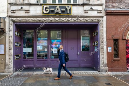 "A man walking his dog passes shut doors of G-A-Y club in London. G-A-Y owner Jeremy Joseph launches legal challenge against the Government's 10pm curfew, he said, ""The 10pm curfew which has now been in place for the last two weeks and has been detrimental to the hospitality sector, including G-A-Y, makes absolutely no sense.  The club owner claims the measures make a ""scapegoat"" of the night time economy and are ""unsafe"" for punters and thus has instructed his legal teams at Simpson Miller Solicitors and Kings Chambers to challenge them."