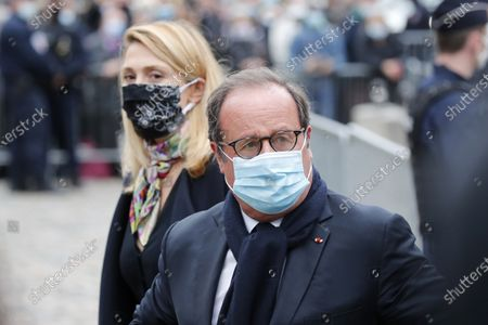 French former president Francois Hollande, second left, and partner French producer and actress Julie Gayet, right, attend the funeral ceremony of French singer Juliette Greco at the Saint Germain des Pres church in Paris, . French media say Juliette Greco, singer, actress, cultural icon and muse to Existentialist philosophers of France's post-War period, has died aged 93 on Wednesday, Sept. 23, 2020, in her Ramatuelle house in the south of France, near Saint Tropez