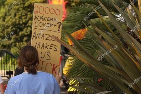 BEVERLY HILLS, CA - OCTOBER 04, 2020 - Protesters rally in Will Rogers Park before marching to Amazon founder Jeff Bezos' mansion to lobby for higher wages, the right to unionize and a series of reforms in the way the giant company handles the COVID-19 crisis in Beverly Hills on October 4, 2020. Demonstrators ended their march at the front gate of Bezos' home. The event was organized by The Congress of Essential Workers and led by Chris Smalls, a former Amazon employee in Staten Island, N.Y., who was fired in March shortly after he helped organize a work stoppage at the company's warehouse to protest what he called a lack of protective gear and hazard pay for employees. (Genaro Molina / Los Angeles Times)